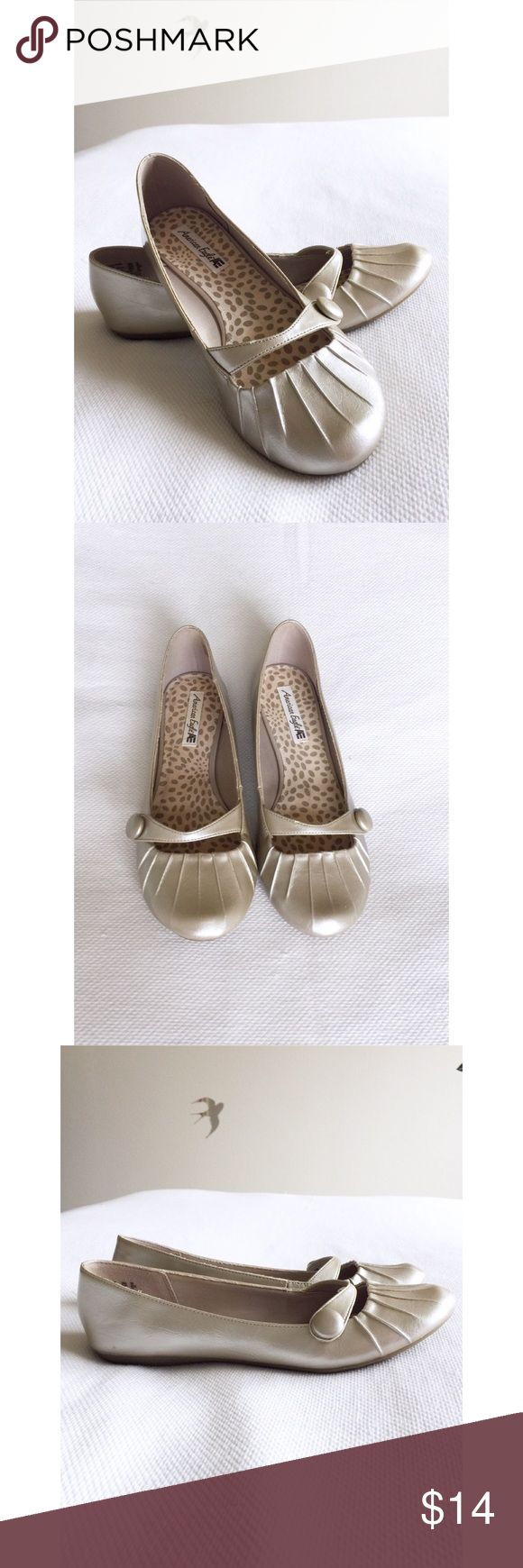 Metallic Flats Adorable Mary Jane style flats with button detail and a subtle metallic shine. Shoes Flats & Loafers