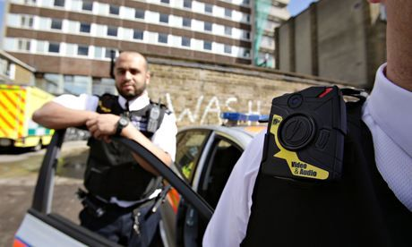 Constable Yasa Amerat (left) and Constable Craig Pearson wearing their body-worn video cameras. Photograph: Yui Mok/PAhttp://www.theguardian.com/uk-news/2014/may/08/police-london-issued-body-worn-cameras