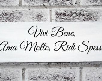 "Italian saying sign ""Live Well, Love Much, Laugh Often"" in Italian"