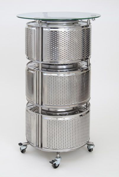 A bistro table on castors made from three washing machine drums by Trash Design
