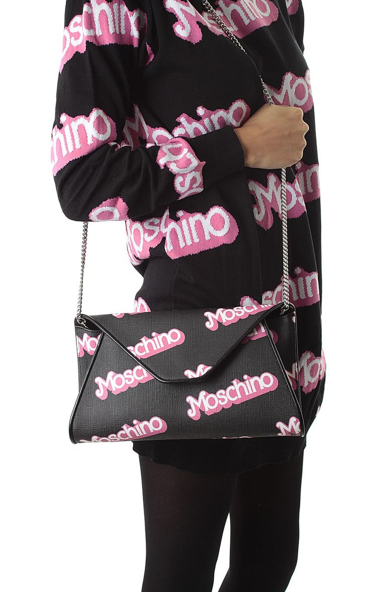 #Moschino #capsulecollection #ss15 logo printed clutch, check it out here -> http://www.bagheeraboutique.com/en-US/designer/moschino_capsule_collection_ss15