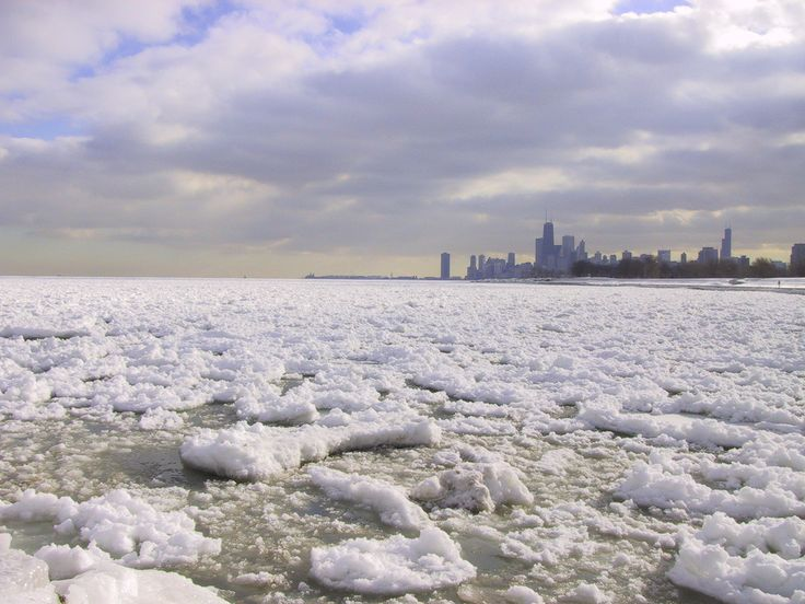 Looking south to Chicago skyline across frozen Lake Michigan.