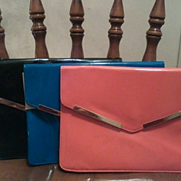 Bundle of 3 clutches Three Nicki Manaj envelope clutches. Black, blue and coral. They all have some discoloration on them from being in my closet as shown on the coral one. Any questions ask. Make an offer. nicki minaj Bags Clutches & Wristlets