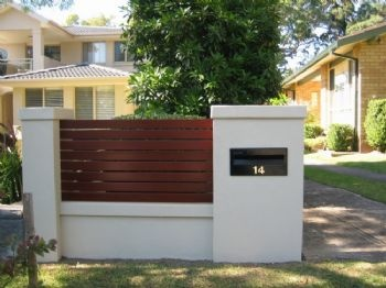 Customised letterbox post mounted on this front entry EstateWall.