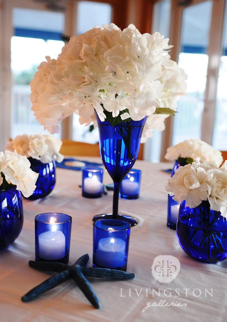 royal blue and silver wedding centerpieces%0A Cobalt glass and peonies