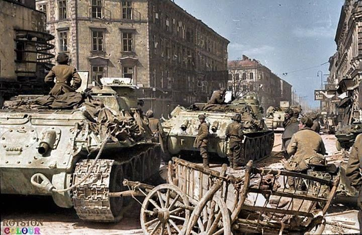 Soviet SU-100 Tank destroyers arriving in Vienna, April 1945. The SU-100 arrived in operational units in October 1944 and immediately became popular with Russian crews. It was able to defeat almost every German tank on the battlefield, only to be outmatched in 1945 by the King Tiger. It became instrumental in fending off German units during Operation