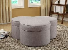 Limerick Storage Ottoman HE-4608GY Functional storage ottoman features a playful cloverleaf shape in the Limerick Collection. The padded lid of the ottoman removes to reveal a large storage bin. Casters allow for quick and easy placement in your home. The ottoman is offered in grey in grey fabric. Materials:-Fabric Dimensions:42.25 x 39.75 x 17H