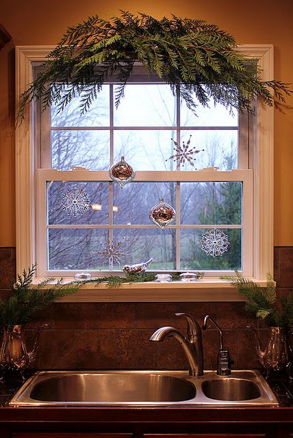 Such a beautiful simple christmas kitchen window! I love the bird... might even put the branches over our front door so when you walk in it will instantly smell like Christmas!