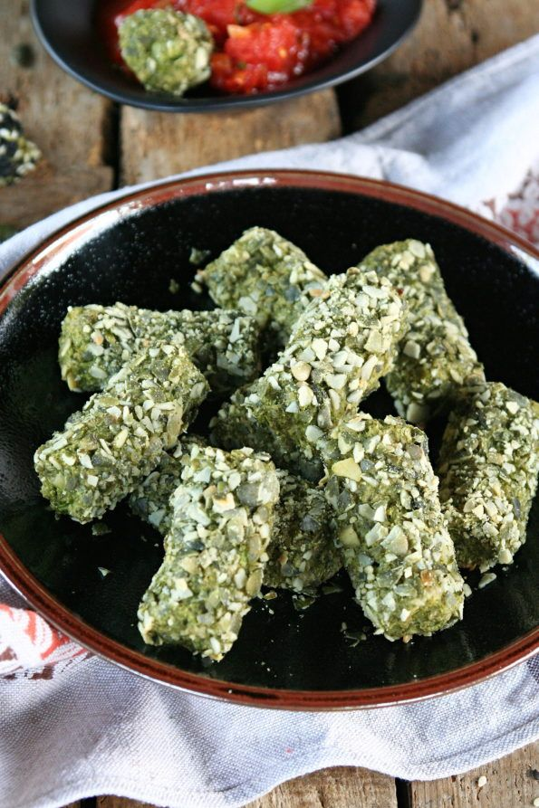 Broccoli peaces with pumkin seeds and tomato dip