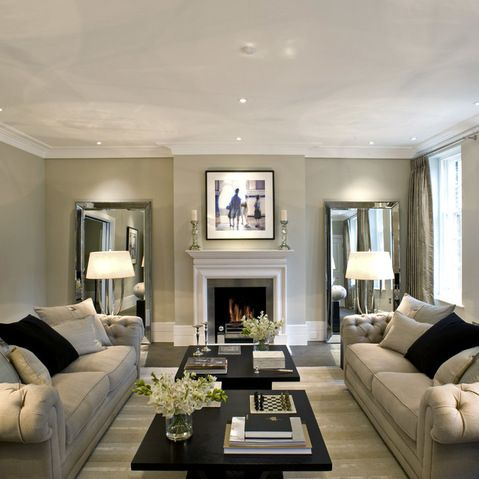 Using mirrors at the closed end of the room with lamps in front gives this room depth & the illusion of being larger.