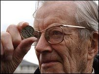 Maurice Wilkins examines one of DNA 50 commemorative coins from last year