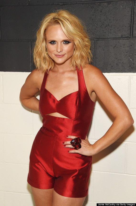 "miranda lambert And Lambert's time in the spotlight didn't end there. The 30-year-old wowed again in a silky red romper complete with sexy cutouts when she performed her song, ""Little Red Wagon"" later that evening. She completed the red-hot look with a pair of gold stiletto booties, chunky bangles and a fun heart-shaped accent ring:"