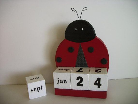 Ladybug Calendar - would be cute with an owl instead. Store the extra blocks in the back.