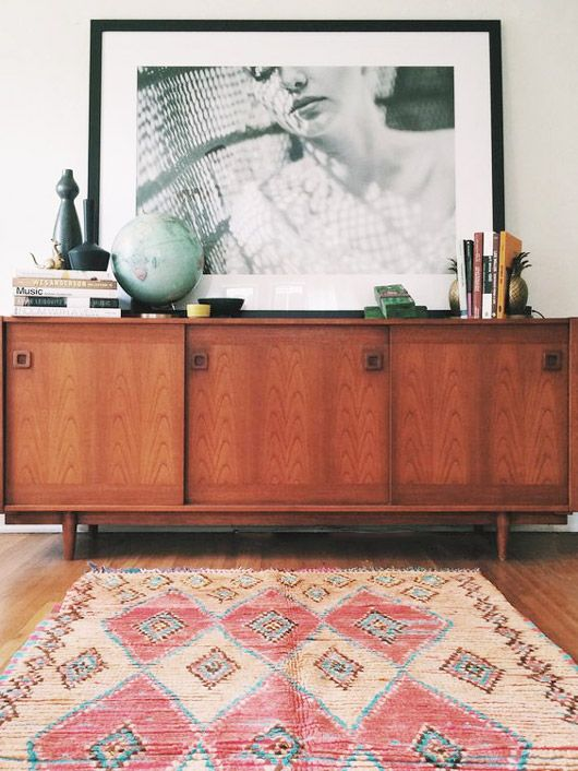 credenza with oversized black and white artwork / coco carpets on sfgirlbybay