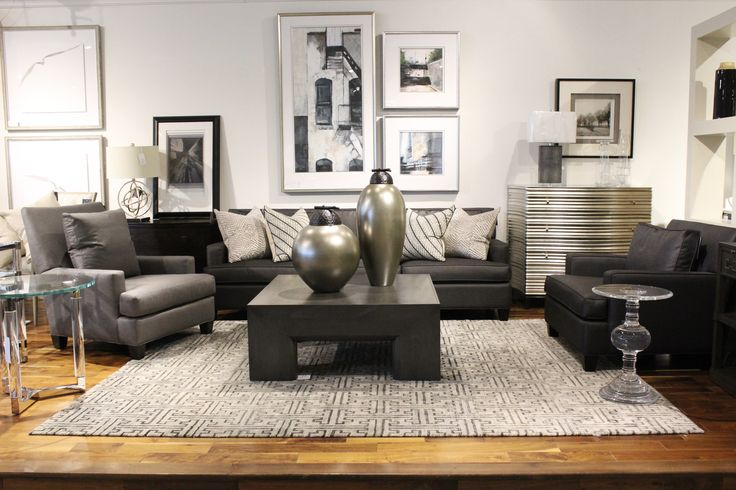 http://www.avenuedesigncanada.com Acrylic end table, custom Canadian upholstery, silver vase and limited edition prints.  Avenue Design Canada