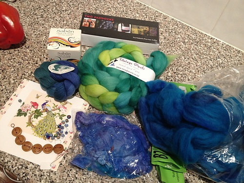 """""""Green VP Perendale [fibre], peacock merino from BJs with matching silk hankies, lace yarn, stitch markers, buttons, pinot noir truffles and my all time favourite - Syrian olive oil soap."""""""