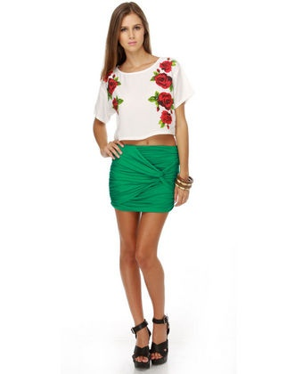 Twisted Green Mini Skirt I really like the green skirt, not crazy about the top much... umm, giant red roses, nah!