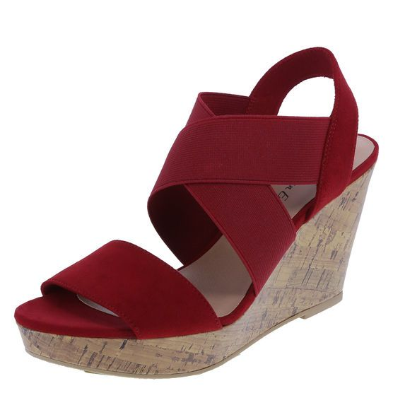 3d68bf98715 This cute and comfortable sandal features a combination faux suede and  stretchy gore upper