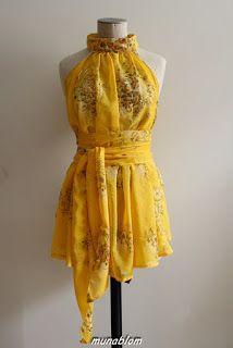 Sylar: Blusa in sari indiana con cinta in vita.