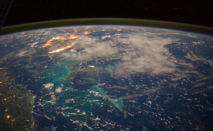 The Caribbean Sea in the early morning hours of July 15, photographed this north-looking panorama that includes parts of Cuba, the Bahamas and Florida, and even runs into several other areas in the southeastern U.S. The long stretch of lights to the left of center frame gives the shape of Miami.