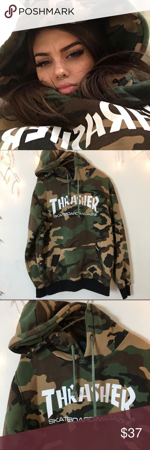 Thrasher Camo Sweater Hoodie Authentic thrasher hoodie. Sold out. Super Duper soft inside fleece material Best for women's small or medium oversized fit as seen on Sahar Luna @sahar.luna on Instagram. In great condition colors are slightly faded but white graphic logo is in perfect condition. Brandy Melville Tops Sweatshirts & Hoodies