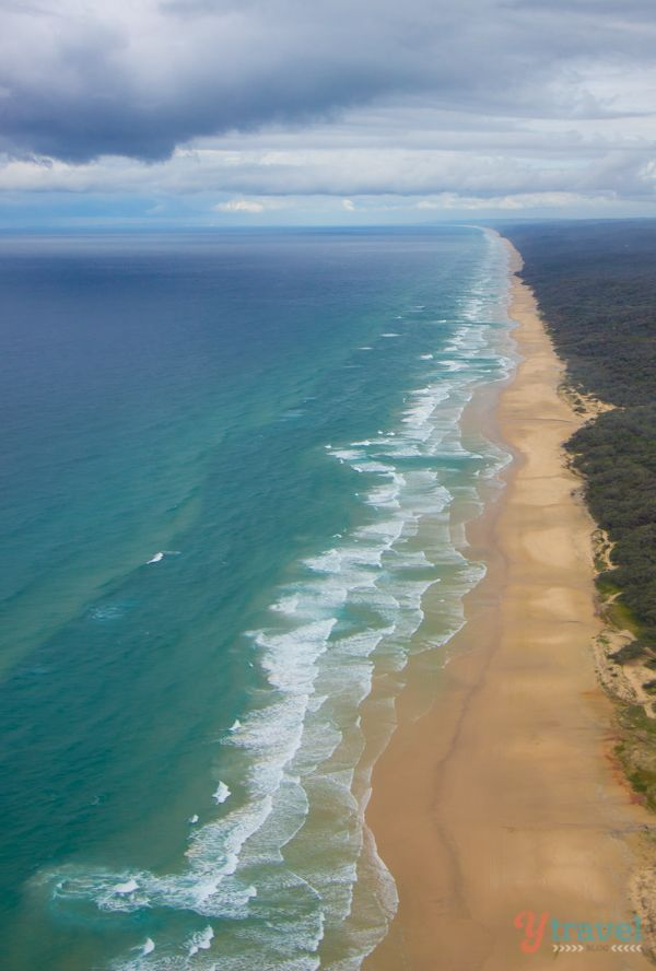 Drive along 75 Mile Beach on a road trip around Fraser Island in Queensland, Australia