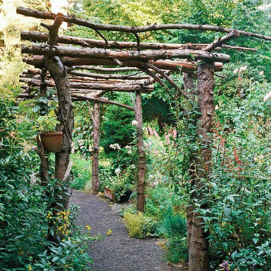 Simple Tunnel Arbor  With a rustic arbor's design, less is more. There's no attempt to mimic architectural elements here, just the structural basics required to hold the roof up and keep everything steady. A jumble of roses and other flowers provides the perfect setting for the live-branch tunnel arbor.