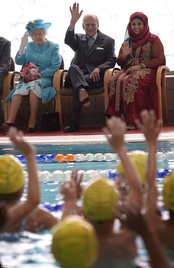 2015: The royal couple wave to school children during a visit to the Abbey Leisure Centre ...