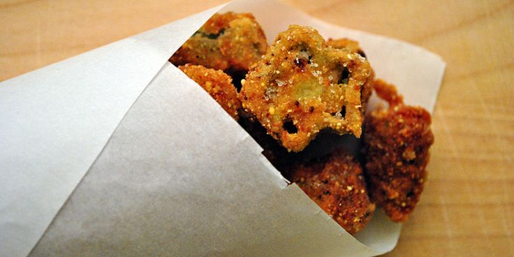 FRIED CORNMEAL OKRA   |   Okra is originally from West Africa, for it was introduced to the American South by the Atlantic Slave trade. Traditional African-American recipes mix okra with tomatoes, lima beans and corn. Find them in soups or stews such as gumbo and jambalaya. In this recipe, okra is fried in a cornmeal batter.  Instead of eating fried okra by itself, try adding Fried Cornmeal Okra in a salad of romaine lettuce, corn, tomatoes, green bell peppers and grilled chicken.