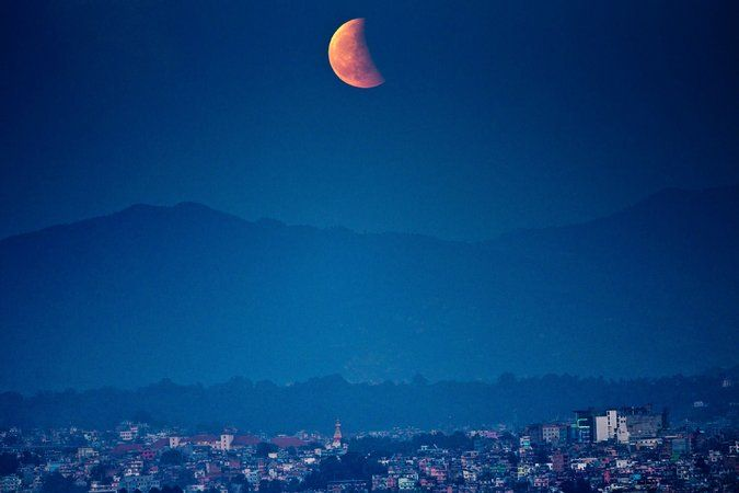 Lunar Eclipse in Asia and the Americas By THE ASSOCIATED PRESS 10/8/4 - NYTimes.com The moon glowing red over Katmandu, Nepal, Wednesday during a total lunar eclipse.  Credit Narendra Shrestha/European Press