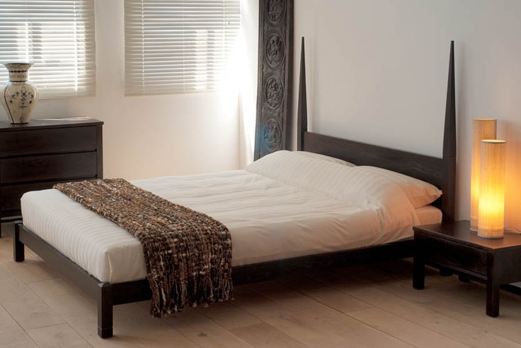 The mali wooden bed has a dramatic style with pencil post for Dramatic beds