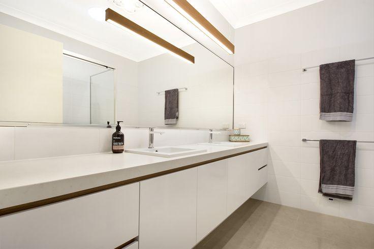This beautiful bathroom vanity features Essa Stone Carrara Matt benchtops with a Laminex Honey Elm recessed rail.