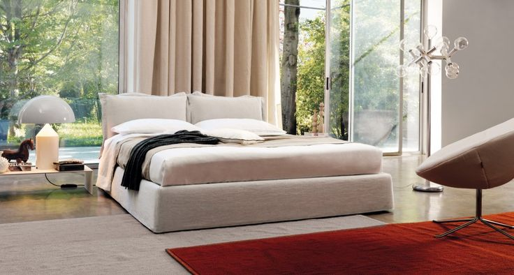 """VANITY - A soft and cozy bed. Softness and warmth are the indisputed quality of the bed Vanity, characterized by soft headboard, consisting of pillows """"volant"""" feather and polyester fiber. Available with box and manual or motorized opening mechanism."""