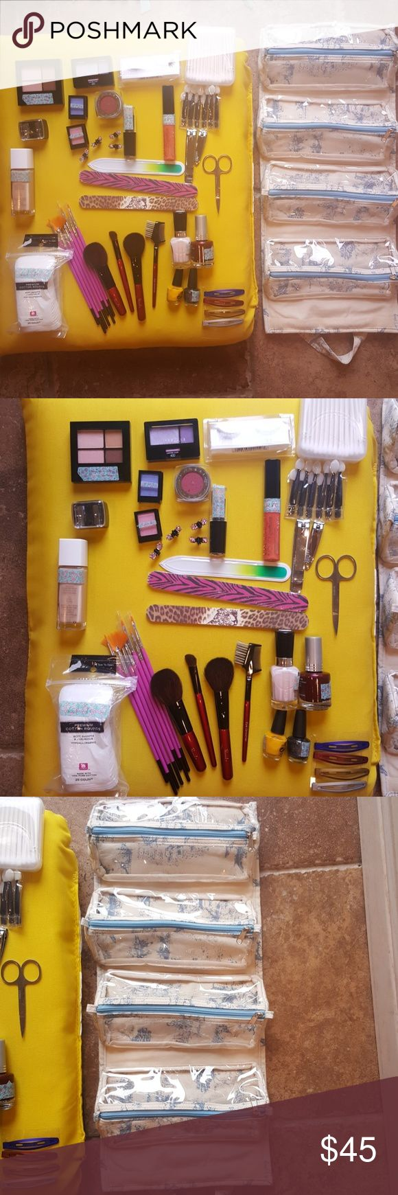 NWT AMAZING BEAUTY deal!! Hanging cosmetics holder PACKED with  brand new, never been used,cosmetics:  * Hanging cosmetics bag/removable compartments * 11 makeup brushes *  8 hair clips * 1 Revlon Foundation * 4 nail polishes *2 nail clippers, cuticle scissors, 3 nail files *bag of cotton rounds, box of Q tips, * 12 eye shadow applicators * 1 set black eyelashes *  eye/lip pencil sharpener * 8 eye-shadows * 1 Loreal eye shimmer * 2 Lip shines  These were purchased as background prop for…