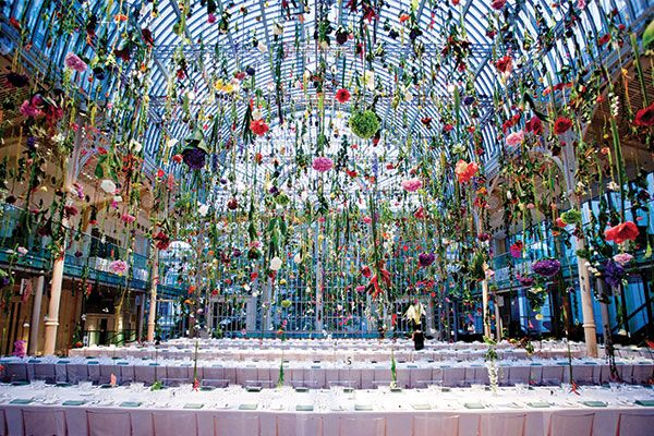 Garden blooms dangled from the glass ceiling of the Floral Hall inside the London Royal Opera House for the Ballet and Banquet affair hosted by Hermès. Photo courtesy of Rebecca Louise Law