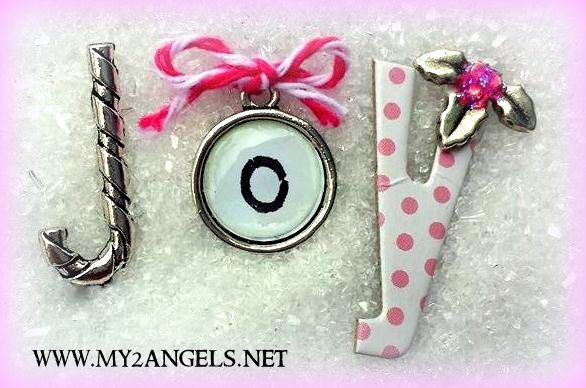 """grab one of our Candy Cane Charms and snip off the loop - now you have a """"J"""" (turn it the other way round silly!). Tie a bow with Baker's Twine to the top of a silver """"o"""" typerwriter charm, grab a """"y"""" letter from your stash and pop on a mistletoe charm (I have added glam pink stickles to the berries to match my pink twine). Products are available from www.my2angels.net"""