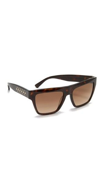 Thick frames and a flat-top shape give these MCM sunglasses a bold, futuristic feel. Metal studs accent the sides. Hard case and cleaning cloth included.