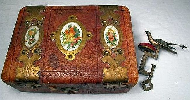 VICTORIAN SEWING BIRD and LEATHER SEWING BOX.
