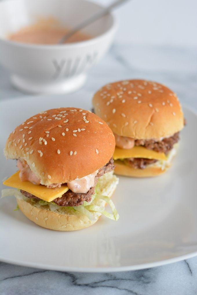 Mini Big Mac Sliders on a white plate.