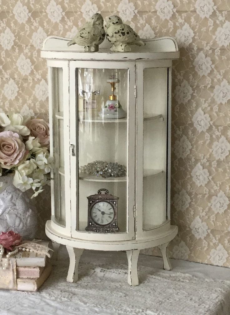 A personal favorite from my Etsy shop https://www.etsy.com/listing/289930879/shabby-curio-cabinettable-top-curio