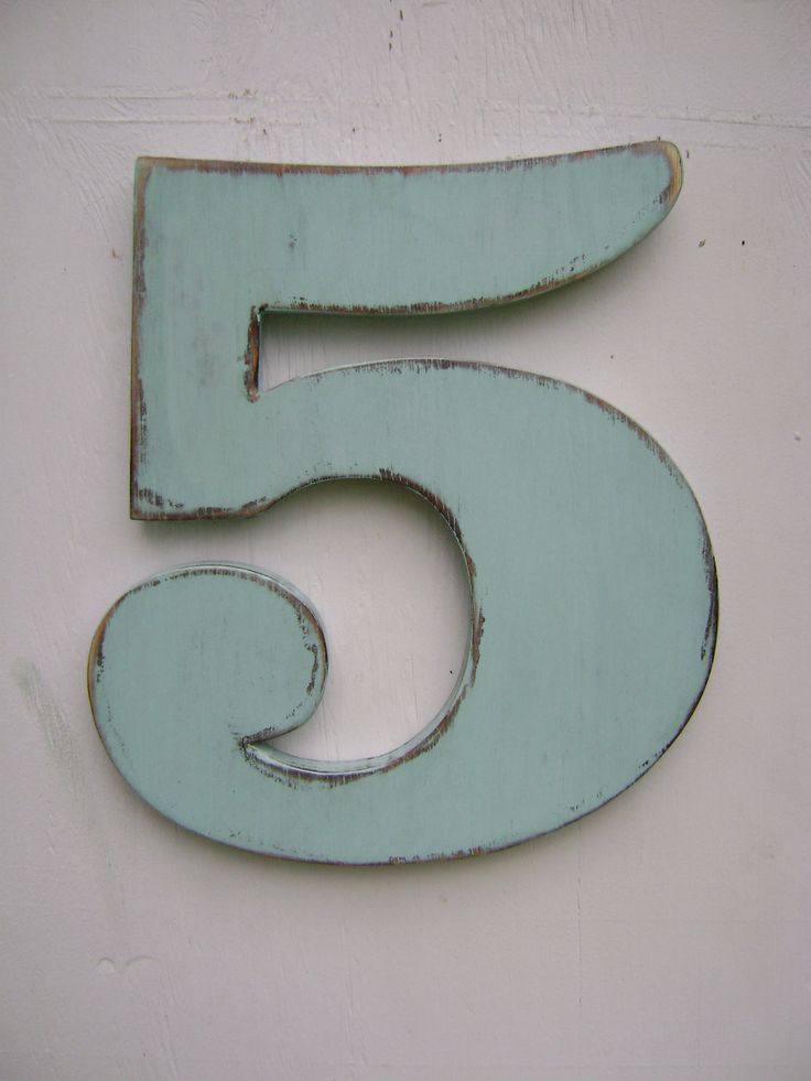 Love the blue they chose to paint the five with. Neat idea for farmhouse bedroom doors or a bread and breakfast.