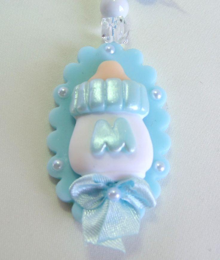 Atenção: enviar a letra do nome do bebê  Cor: azul  Material: biscuit e miçangas