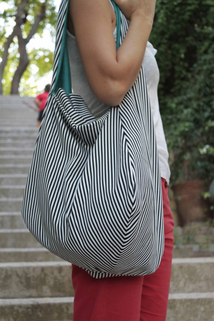 white blue striped/ green bag. Double sided with zipper