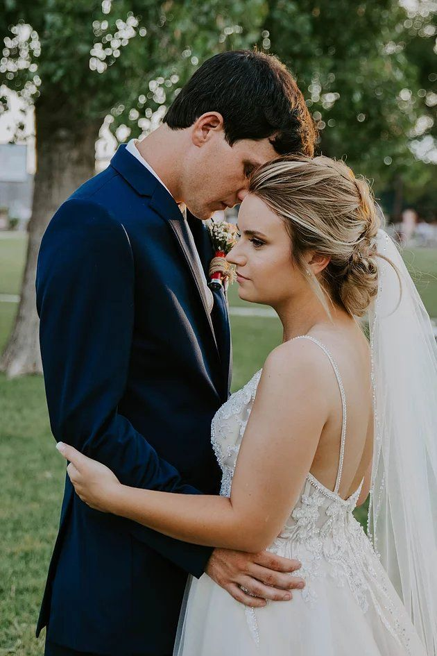 A Braided Up To Wedding Hairstyle David S Bridal Bride Katelyn