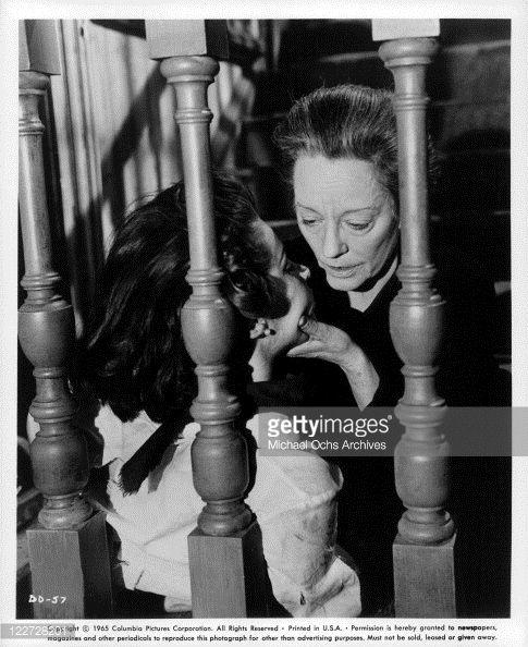 Captive Stefanie Powers has her head held by Tallulah Bankhead in a scene from the film 'Die Die My Darling' 1965
