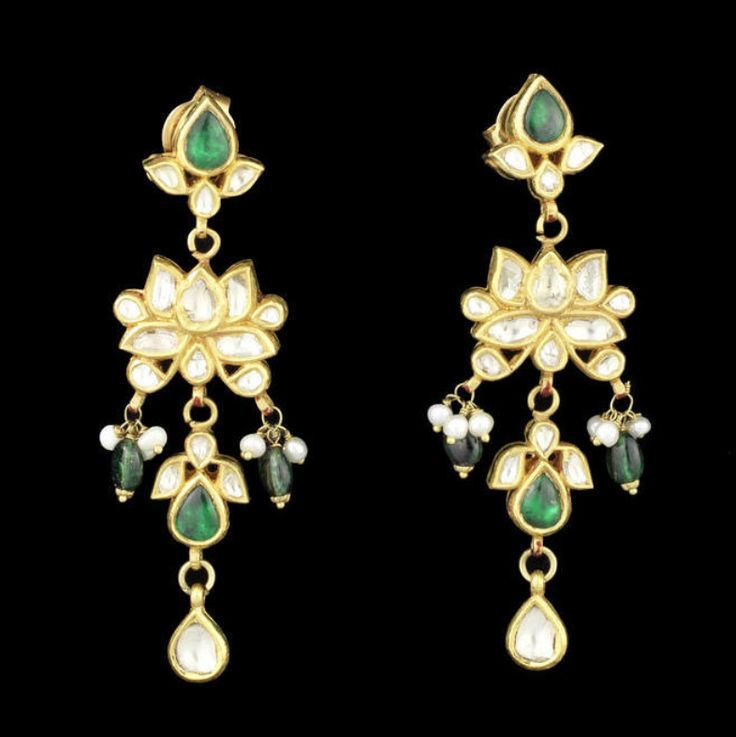 A pair of diamond and emerald-set gold pendent Earrings India, 20th Century comprising lotus-shaped section set with diamonds and with two emerald bead and seed pearl suspensions, sections in the form of floral spray set with diamonds and emeralds above and below, terminating in drop-shaped diamond suspension, verso with polychrome floral enamelled decoration, fitted with post and screw