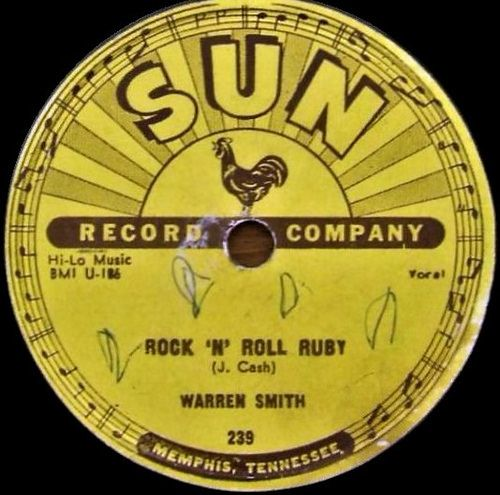 "Warren Smith - Sun Records # 239 - 1956 | Side A - Rock 'N' Roll Ruby. Side B - I'd Rather Be Safe Than Sorry.  One night in February 1956, Sam Phillips showed up at the Cotton Club while the Snearly Ranch Boys were playing. Johnny Cash accompanied him and they invited Warren Smith to their table. Phillips suggested Smith and the Boys should record ""Rock'n'Roll Ruby,"" which Cash obviously didn't consider for himself. A couple of days later, on February 5, the"