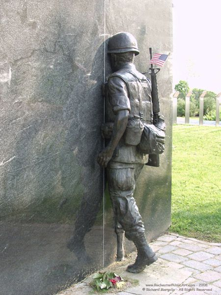 Vietnam War Memorial by William Yager.    Description: Soldier marching into a granite slab, set in a memorial garden    Caption: This Memorial commemorates the 280 men who gave their lives for freedom, and to educate future generations about their experiences, sacrifices, and to aid in healing for all those left behind. A steel bollard is dedicated to each man.