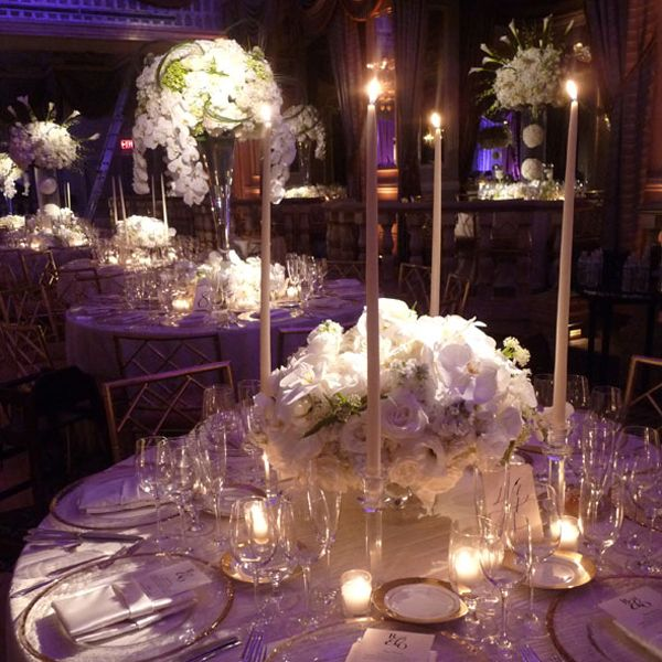 Absolutely gorgeous collection of flowers. Alternating high and low centerpieces avoids sea-of-white boring arrangements, but won't take away from the beauty of the venue.