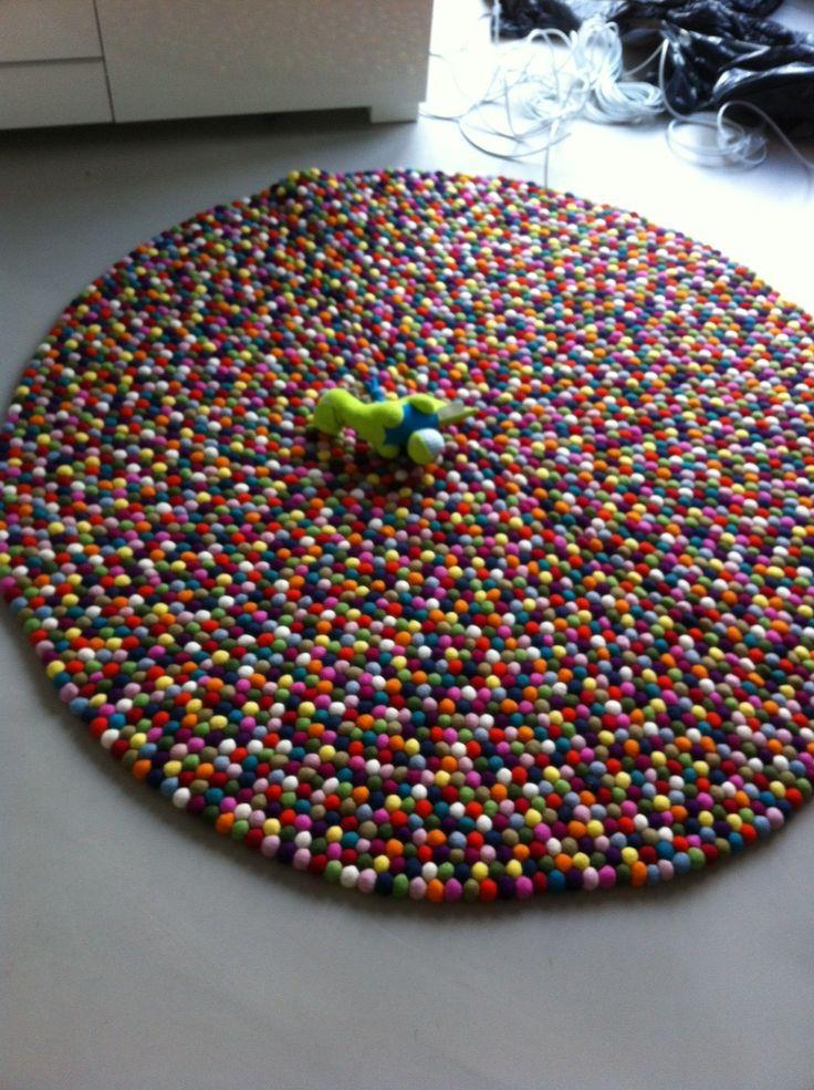 140cm Multi-colour Felt ball rug in living room
